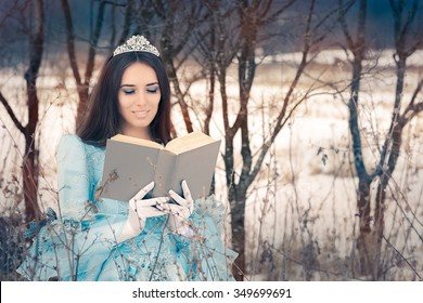 Beautiful Snow Queen Reading a Book - Portrait of a happy beautiful queen in royal dress reading a story book