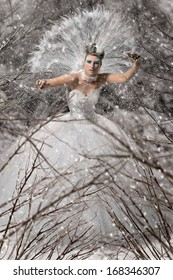 Beautiful snow queen in winter forest
