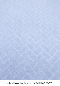 Beautiful snow texture on the pavement for graphical background use