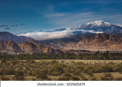 Beautiful snow-covered Mount San Jacinto rises above the Coachella Valley and San Gorgonio Pass Wind Farm, Palm Desert, California
