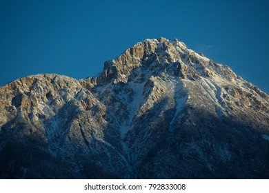 Beautiful snow-covered peak in Austrian Alps starts to shine as the sun rises