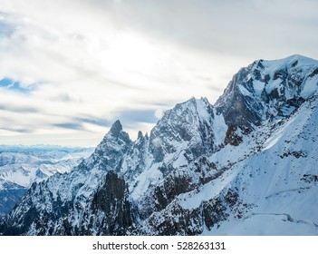 Beautiful snowy mountain peaks in Autumn