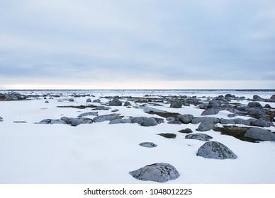 Beautiful snowy and rocky coastline at the swedish island Oland in the Baltic Sea