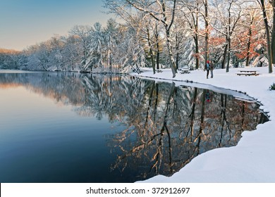 beautiful snowy scene at sunset with a couple kissing in the distance