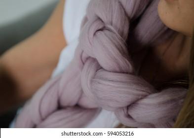 beautiful soft pink knited merino wool scarf, close up
