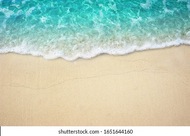 Beautiful Soft Turquoise ocean wave on Fine sandy beach Summer Background Concept