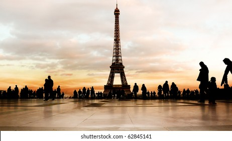 Beautiful soft-colored sky at dusk behind the Eiffel Tower in Paris.