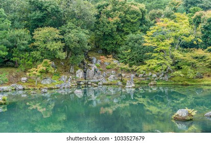 Beautiful Sogenchi Garden at Tenryu-ji temple in Arashiyama, Kyoto. Lake reflections.Designated as a Special Place of Scenic Beauty and UNESCO World Heritage Site