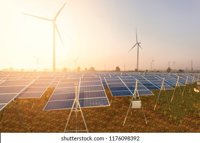 Beautiful Solar panels with wind turbines landscape blue sky with clouds and (solar cell) in solar farm with sun lighting to create the clean electric power Concept.