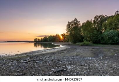 Beautiful solor sunset by the lake, Rozkos, Czech republic - Shutterstock ID 1440923987