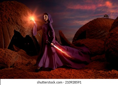 Beautiful sorceress with magical sword in chocolate mountains