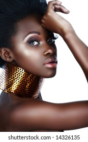 beautiful south African woman with bronze necklace and natural make-up with lots of shine - not isolated
