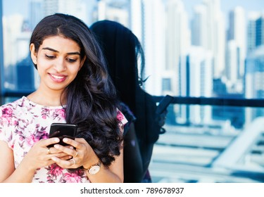 Beautiful south indian woman chatting on phone