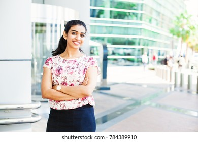 Beautiful south indian woman confidently standing and looking at camera