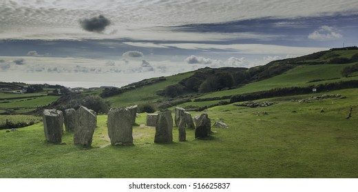 beautiful southern Irish landscape near the coastal town of Drombeg in county cork, featuring the famous Drombeg stone circle, situated near a pre-historic settlement site.