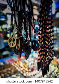 Beautiful souvenirs are hanging in the souvenir market of Pondicherry. Colourful souvenir items are being sold in Pondicherry near beach road. Beach market in Pondicherry.