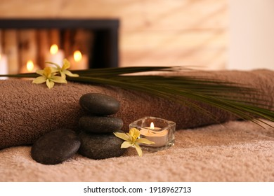 Beautiful spa accessories on massage table in room