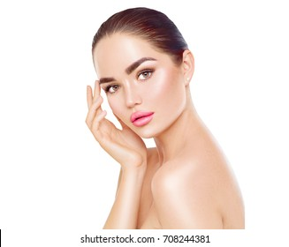 Beautiful Spa Brunette Woman Touching her Face. Perfect Fresh Skin. Beauty Portrait. Pure Beauty Model Girl. Youth and Skin Care Concept. Isolated on white background.