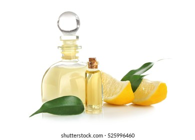 Beautiful spa composition with lemon essential oil on white background, closeup