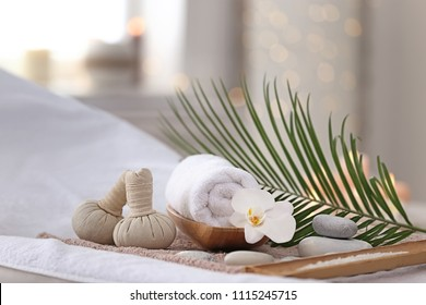 Beautiful spa composition on massage table in wellness center - Shutterstock ID 1115245715