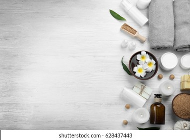 Beautiful spa composition on wooden background - Shutterstock ID 628437443
