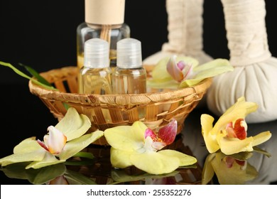 Beautiful spa composition with orchid on dark background