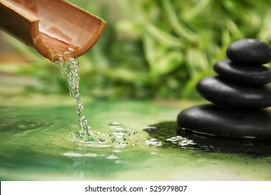 Beautiful spa composition with pouring water and stones