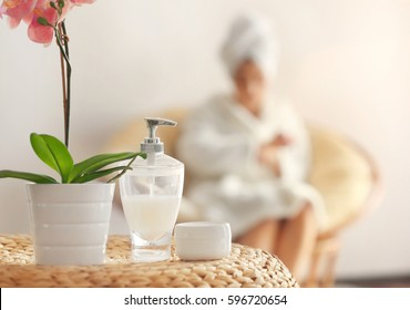 Beautiful spa composition in salon with blurred woman on background