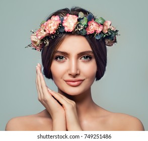 Beautiful Spa Model Woman with Healthy Skin. Spa Girl Smiling on Blue Background. Spa Beauty, Facial Treatment and Cosmetology