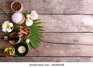 Beautiful spa setting on palm leaf on wooden table