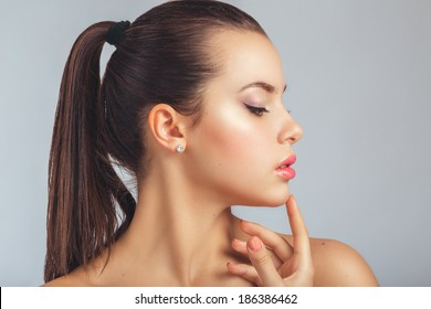 Beautiful Spa Woman Touching her chin. Youth and Skin Care Concept.