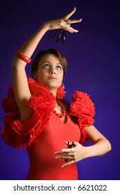 Beautiful Spanish flamenco dancer with her castanets
