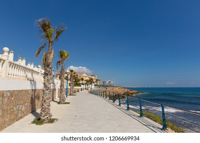 Beautiful Spanish paseo coast path by the sea between La Zenia and Playa Cala Capitan Spain