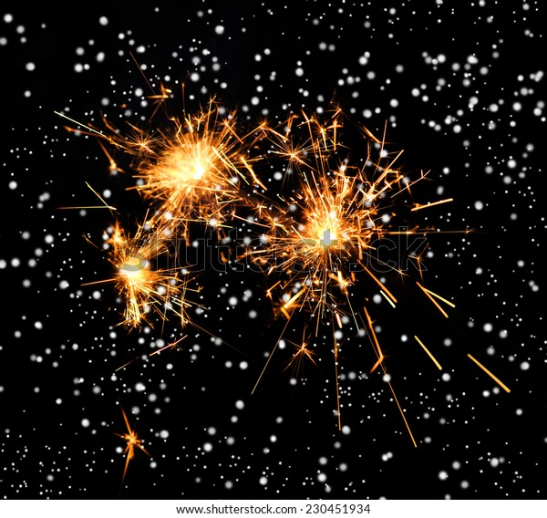 Beautiful sparkler on black background. Christmas and holidays concept