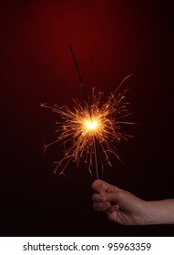beautiful sparkler on red background