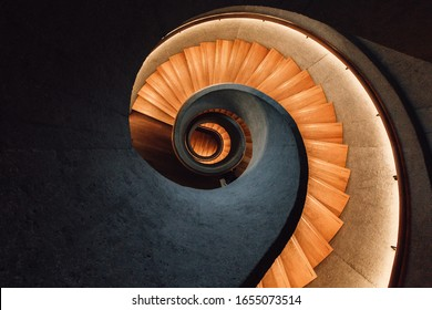 Beautiful spiral staircase of interior design at Tai Kwun - Centre for Heritage and Arts in Hong Kong.