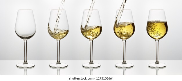 Beautiful splash of wine in glasses on a white background. Set of five glasses of wine