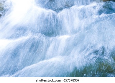 Beautiful of sponge flows from the waterfall. Tides from the waterfall. Soft focus, concept of nature background.