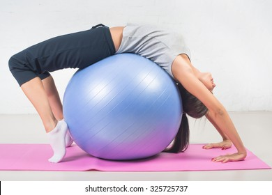 Beautiful sport woman doing fitness exercise, stretching on ball. Pilates, sports, health