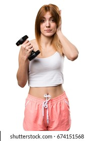 Beautiful sport woman with dumbbells covering her ears
