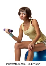 The beautiful sports girl with dumbbells on a white background. Training.