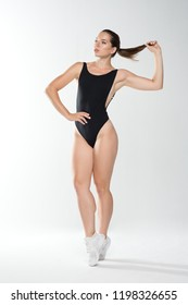 Beautiful sports woman in black body on white background