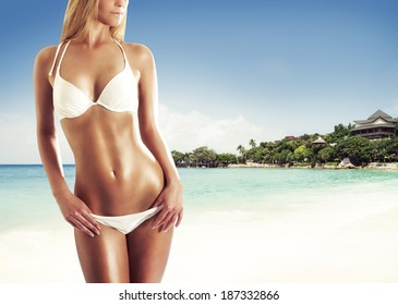 Beautiful and sporty body of sexy woman over the summer background