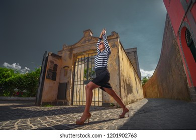 Beautiful sporty fit blond young woman doing yoga practices yoga asana Virabhadrasana - warrior pose