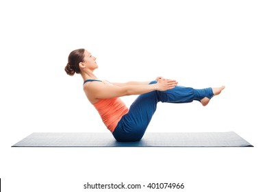 Beautiful sporty fit woman doing Ashtanga Vinyasa yoga asana Paripurna navasana - boat pose beginner variation isolated on white background