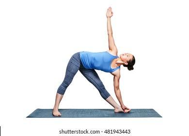 Beautiful sporty fit woman practices Ashtanga Vinyasa yoga asana utthita trikonasana - extended triangle pose isolated on white