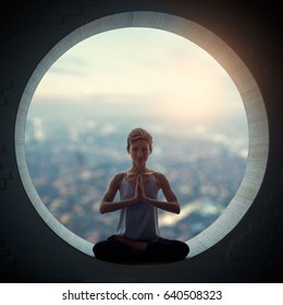 Beautiful sporty fit yogi woman practices yoga asana Padmasana - Lotus pose in a round window with a view of the city