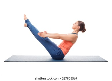 Beautiful sporty fit yogini woman practices yoga asana Paripurna navasana - boat pose isolated on white background