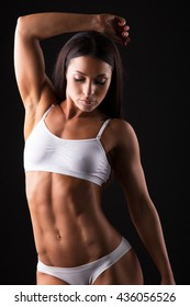 Beautiful sporty woman body. Isolated on black background