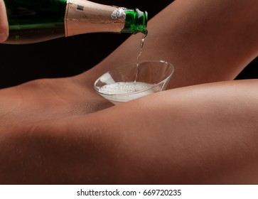 Beautiful sporty woman body. Sexy female slim tanned girl. Bottle of champagne. Sexy woman body - studio shot. Party concept. Erotic concept photo. Sexuality concept. Erotica concept. Fashion